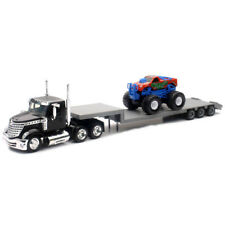 New Ray 1/43 Long Haul Trucker International Lonestar Flatbed With MONSTER Truck