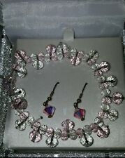 Bracelet and earing set, made with swarovski crystal, never worn, pink and clear