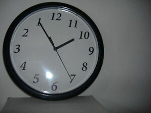 Backwards clock runs counter clockwise novelty
