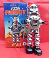 Robot mécanique en tôle. PLANET ROBOT modèle argenté ROBBY de Planète interdite.