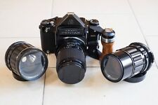 Pentax 67 (not mirror up) with wooden grip 75mm, 135mm macro and 200mm lenses