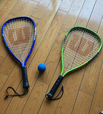 2 wilson squash racquet with a ball