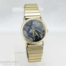 GENEVA MENS WATCH BLACK PEARLIZED DIAL GOLD TONE STRETCH BAND 1 J' SWISS MVT