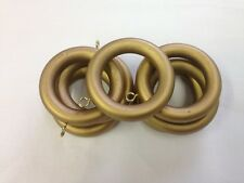 "Seven wooden antique gold curtain rod rings for 1-3/8"" rod"