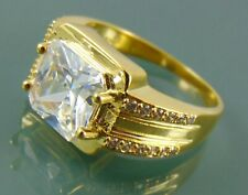 Gold plated ring with large clear square cubic zirconia solitaire and accents