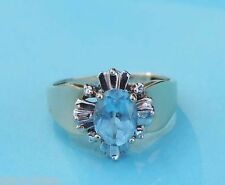 Ladies Genuine Oval Blue Topaz Ring w/ 2 Genuine Diamonds - 10K Yellow Gold