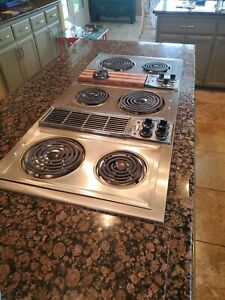 Jenn Air stainless steel electric cooktop with downdraft. Works great!