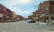 THE BUSINESS SECTION LOOKING WEST COLUMBUS, NE REXALL DRUG STORE 1950'S AUTOS