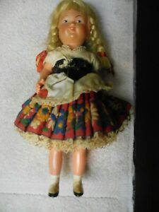 """10.5 & 9"""" celluloid pair of international dolls turtle mark and trident mark"""