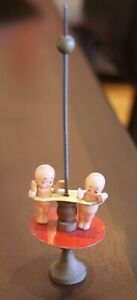 Antique Vintage Spiral Penny Toy With Two Celluloid Kewpies
