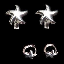Boucles D'oreilles mixte homme femme mini créoles étoile de mer argentée reliefs