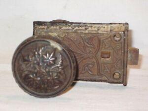 ornate antique door knobs knob lock set locking handle latch cast iron flower ?