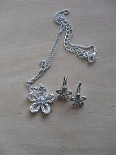prettylittle silver flower diamote necklace and leverback earrings