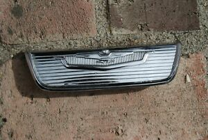 1955-56 Chrysler Imperial Rear of Front Seat Ashtray Bezel / Emblem NICE 1602380