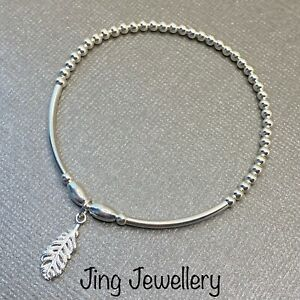 Sterling Silver 925 Stretch Noodle Bead Stacking Bracelet Feather Charm Handmade