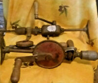 vintage collectable hand drills by three differant sizes makes