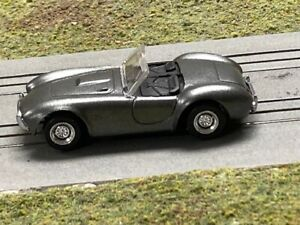 Aurora AFX Tomy Mega G + Carroll Shelby personal 427 Cobra HO slot car body