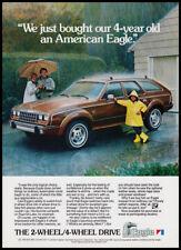 American Eagle wagon print ad 1983 Am. Motors - couple w/ son in rain, umbrella