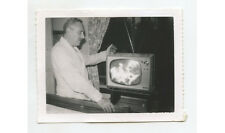 MAN WATCHING BLACK + WHITE TELEVISION SHOW, SNAP SHOT PHOTO
