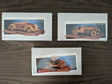 Three brand new model wooden car kits from the Vintage Car Club of America
