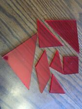 7 piece tangram puzzle brain teaser.  IQ. Make many shapes.  Red clear plastic