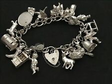 Vintage Sterling Silver Charm Bracelet, With 21 Sterling Silver Charms.