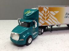 HO 1/87 TNS # 126 I.H. Prostar Daycab w/28' Reefer Doubles, Food Services