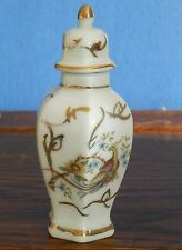 A miniature hexagonal Porcelain baluster jar hand gilded with exotic birds