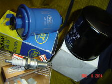 6 Zündkerzen Benzinfilter Ölfilter Mitsubishi Pajero 1 2 V23 L141 Shogun 3,0 V6