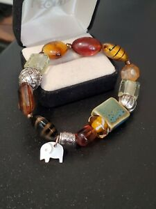 Glass Bead Stretch Bracelet Hand Carved Mother of Pearl Elephant Charm Ceramic