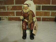 SANTA SITTING IN A CHAIR HOLDING A CHILD--SCULPTURE BY DON EPHRAIM--SIGNED
