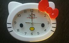 Hello kitty Wall Clock. Red Bow.17.5cmx14cmx4cm.comes with one AA battery.