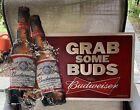 "Embossed Budweiser Beer Metal Tin Sign Grab Some Buds 23"" x 18.5"" Mfg Date 2011"