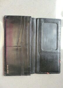 Black leather purse/wallet with zip compartment plus slip pockets..