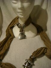 jewelled scarf in brown with silver heart with a leaf design