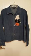 Long sleeved, collared, button front denim Halloween  shirt in size XL.