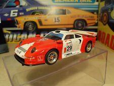Scx PORSCHE 911 GT1-motor mejorado equipado con ruedas de mosca y parte trasera neumáticos.