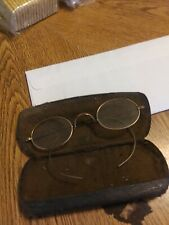 A Vintage Pair Of Glasses With Just Wires Earpieces In A Case