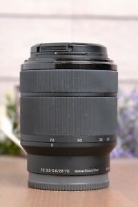 Sony FE 28-70mm f/3.5-5.6 OSS Lens (SEL2870) with Caps *BROKEN FOR PARTS*