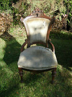 Pair of nurse motif walnut Victorian parlor chairs attributed to John Jelliff
