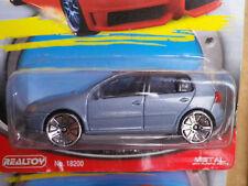 REALTOY Action City VW GOLF 5 1:57 neuve en boite jamais ouverte.