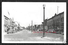 Kelowna rppc Bernard Avenue Empress Theatre Cars BC Canada 1947 stamps