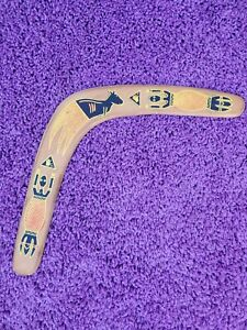 Vintage wooden boomerang with drawings