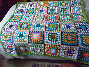 Crochet blanket. hand made. very colourful. size is 43x43 ins square. new.
