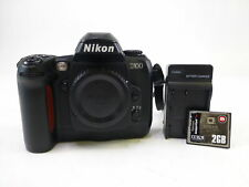 Nikon D100 Body with a Body Cap, Neck Strap, Battery, Charger, and Memory Card