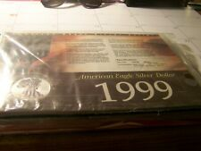 1999 AMERICAN SILVER EAGLE $1 COLORIZED, WITH HISTORY CARD/ CERT OF AUTHENTIC.
