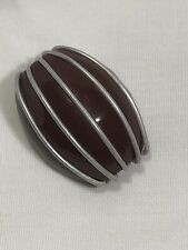 BROWN BAKELITE SHANK BUTTON WITH ALUMINUM STRIPS
