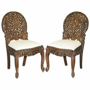 PAIR OF ROSEWOOD HAND CARVED ANGLO INDIAN BURMESE CHAIRS WITH FLORAL DETAILING