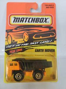1996 MATCHBOX EARTH MOVER DUMP TRUCK #9 - Orange - China Base - Yellowed