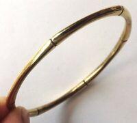 bracelet des année 1970 rigide  en laiton décor style jonc  /168